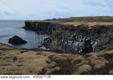 Basalt Columns Along The Rock Cliffs On The Coast Of Iceland.