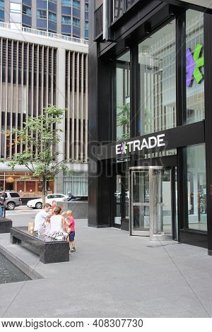 New York, Usa - July 4, 2013: People Sit In Front Of E-trade Office In New York. E-trade Is Morgan S