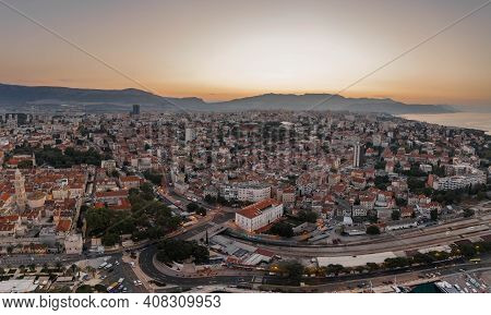 Split, Croatia - Aug 14, 2020: Aerial Drone Shot Of Split Old Town With Sun Rising Over Mount Morso