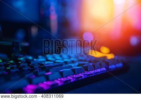 Background Professional Gamer Playing Tournaments Online Games Computer With Headphones, Red And Blu