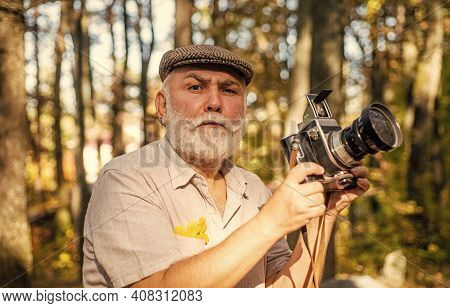 Experienced And Qualified Photographer. Manual Settings. Old Man Shoot In Nature. Cameraman Outdoors