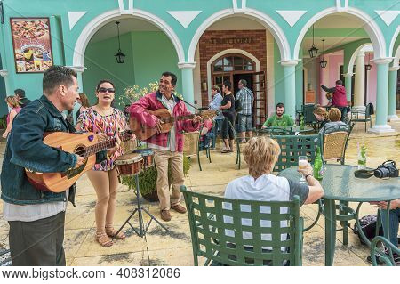 Cayo Santa Maria, Cuba, February 2016 - Trio Of Local Musicians Performing For Tourists On The Patio