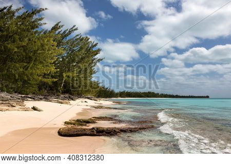 Waves, coral and beach along the shoreline in the Orange Creek area of Cat Island, Bahamas.