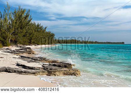 Spray from a wave crashing along a rocky shoreline in the Orange Creek area of Cat Island, Bahamas.