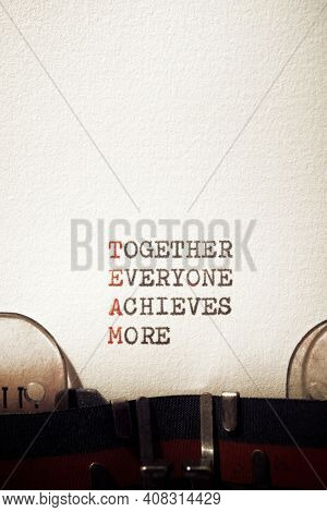 Together everyone achieves more phrase written with a typewriter.