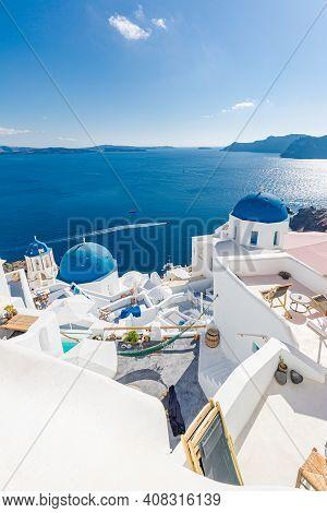 Famous Blue Dome Churches In Oia, (santorini, Greece) In The Morning. White Architecture Of Oia Vill