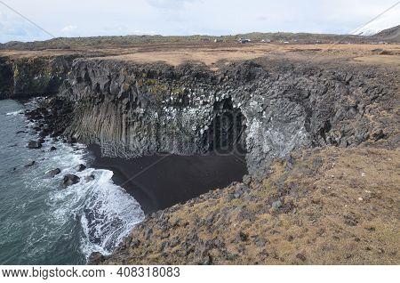 Cavern Made Of Basalt Column Rocks In Iceland.
