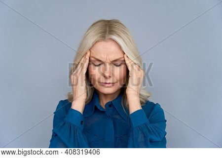 Stressed Frustrated Middle Aged Lady Suffering From Headache Massaging Temples, Close Up View. Tired