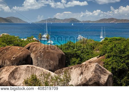 View above the Baths with boats moored in the distance on Virgin Gorda in the British Virgin Islands.