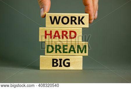 Work Hard Dream Big Symbol. Concept Words 'work Hard Dream Big' On Wooden Blocks On A Beautiful Grey