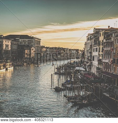 View of the grand canal from the Rialto Bridge at the sunset