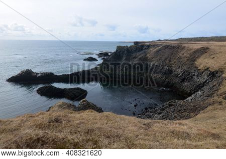 Iceland Seascape With A Rocky Rugged Coastline In A Rural Area.