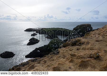 Rugged Black Rock Coast Along The Snaefellsnes Peninsula In Iceland.