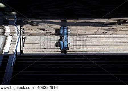 Silhouette Of Man With Suitcase Walking In Empty Underpass And Reflecting Reflected In The Ceiling T