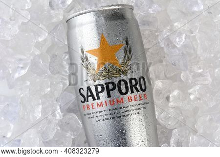 IRVINE, CA - JANUARY 12, 2015: A can of Sapporo Beer closeup on a bed of ice. The Japanese brewery was founded in 1876 by German trained brewer Seibei Nakagawa. It is the oldest beer brand in Japan.