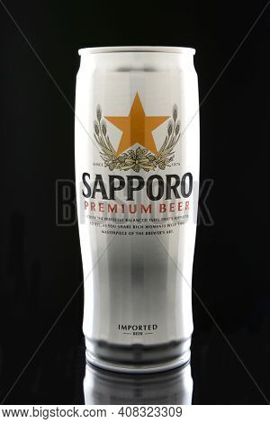 IRVINE, CA - JANUARY 12, 2015: A can of Sapporo Beer on a black background. The Japanese brewery was founded in 1876 by German trained brewer Seibei Nakagawa. It is the oldest beer brand in Japan.