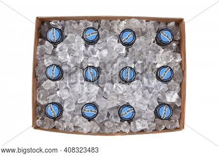 IRVINE, CALIFORNIA - 10 MAR 2020: High angle view of a 12 pack of Blue Moon Belgian White Ale with ice cubes in the box.