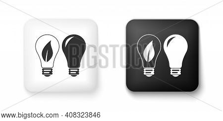 Black And White Classic Lamp And Light Bulb With Leaf Inside Icon Isolated On White Background. Ligh