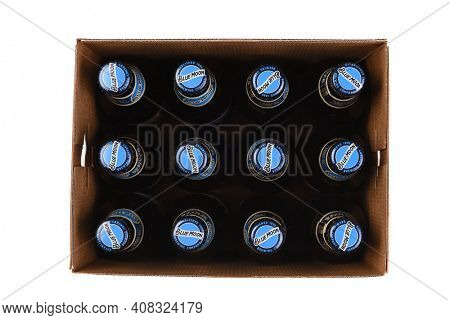 IRVINE, CALIFORNIA - 10 MAR 2020: High angle view of a 12 pack of Blue Moon Belgian White Ale with the lid removed.