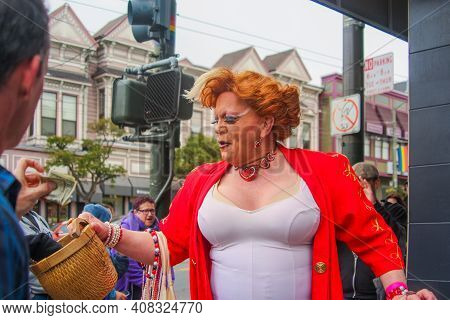 San Francisco, California / United States Of America - May 27th 2013: Cheerful Trans Woman Collectin