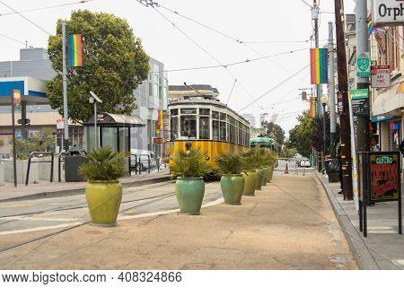 San Francisco, California / United States Of America - May 27th 2013: Nostalgic Yellow Streetcar Goi