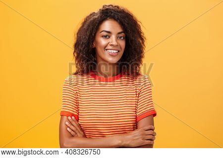Waist-up Shot Of Creative Ambitious Good-looking Female Coworker In Trendy Striped T-shirt Holding H