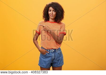 Not Worth My Time. Displeased Unimpressed Stylish Attractive Dark-skinned Female Model In Striped T-
