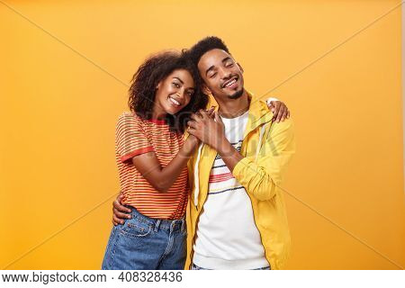 They Love Each Other. Portrait Of Two Charming African American Man And Woman In Relationship Huggin
