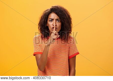 Shh Do Not Disturb. Portrait Of Serious-looking Bossy And Displeased Cute African American Girl With