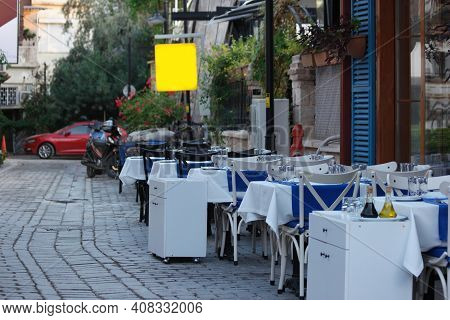 Typical Cafe At Cobbled Narrow Street. Outdoor Cafe At Cozy Street Of Turkish Town.