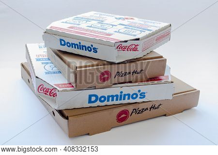 Calgary, Alberta, Canada. Feb 15, 2021. Pizza Hut And Domino's Pizza Boxes On Top Of Each Other On A