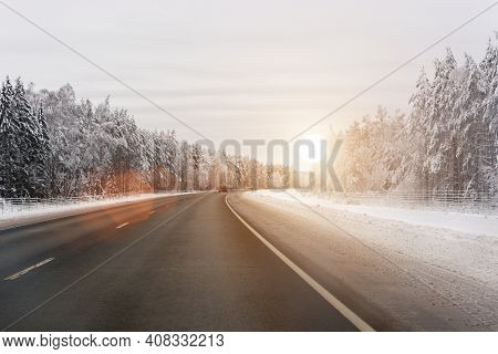 Winter Highway. The Road Leading Through The Winter Landscape. Sunlight. Horizontal Photo