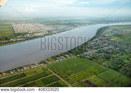 Bird's-eye View Of The Demerara River, Rural Houses, Rectangular Green Fields Taken From An Airplane