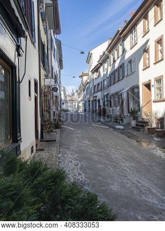 Basel, Switzerland - February 14, 2021: Street View Of The Old Town Of Basel In Switzerland On The F