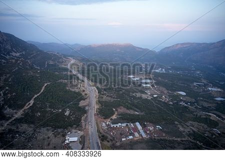 A Stunning Drone View Of The Mountain And Countryside In The Morning. Rural Landscape Of A Road And