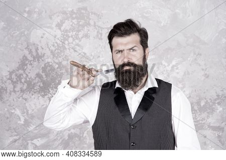 Stainless Steel Straight Edge Razor. Classic Shave. Bearded Man Hold Vintage Razor. Shaving With Str
