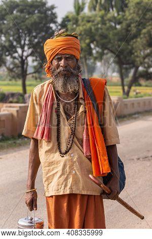Bullapur, Karnataka, India - November 9, 2013: Closeup Of Wandering Sadhu With Saffron Colored Skirt