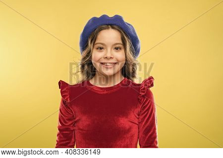 Happy Parisian Girl In French Beret Hat And Elegant Red Dress On Yellow Background, Kid Retro Fashio