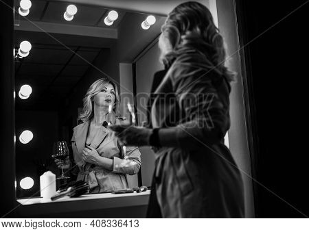 Sensual Portrait Of Middle-aged Seductive Woman With Red Wine Glass Gazing At Mirror Reflection Appr
