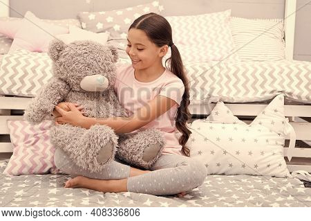Favorite Toy. Girl Child Hug Teddy Bear In Her Bedroom. Pleasant Time In Cozy Bedroom. Girl Kid Long