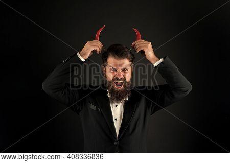 Devil Inside. Stubborn Bearded Businessman Hold Chilli Red Pepper In Hand. Guy Hold Chilli Pepper Bl
