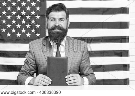 Immigration To United States. Happy Hipster Hold Book American Flag Background. Immigration Examinat