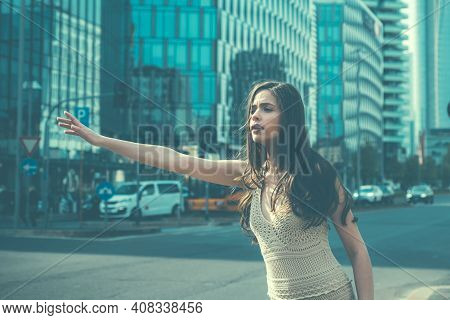 Hailing Taxi. Woman Catch Taxicar On City Street. Travel, Tourism And People Concept. Catching Taxi