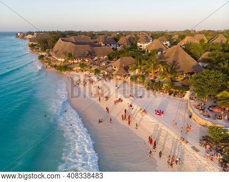 Aerial Shot On Zanzibar A Beautiful Sunset With People Walking On The Nungwi Beach In Zanzibar In Ta