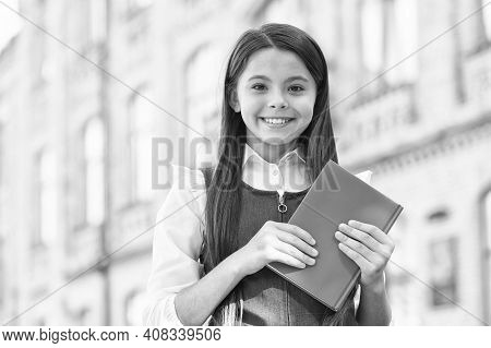 Expand Your Brain By Reading. Happy Child Hold Book Outdoors. School Library. Reading Habit. Home Re