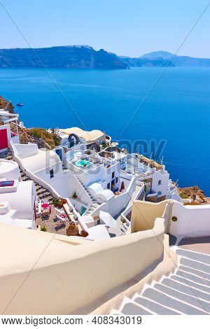 Santorini in Greece. View of Oia (Ia) town on the slope by the sea. Famous resort, greek landscape