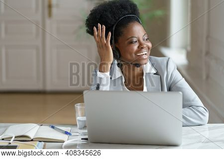 Smiling Afro American Woman Call Center Agent Wearing Headset With Microphone Talking With Customer,