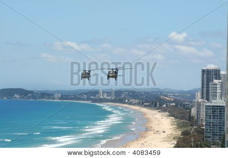 Australian Army Black choppers fly North across Surfers Paradise and Gold Coast beaches Australia. poster