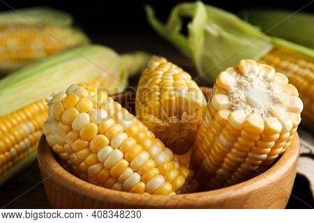 Tasty Sweet Corn Cobs In Bowl On Table, Closeup View