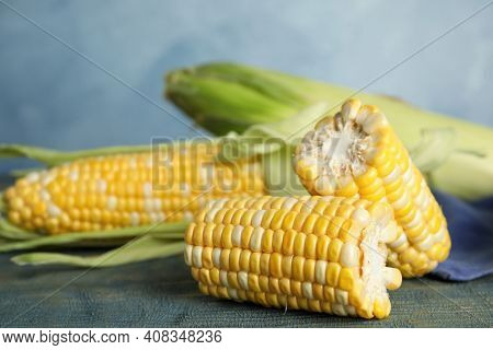 Tasty Sweet Corn Cobs On Blue Wooden Table, Closeup View